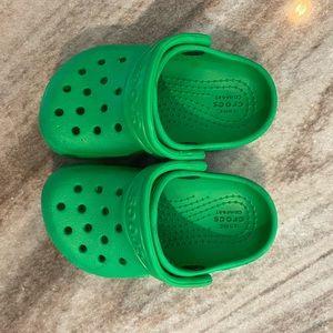 Green kids Crocs